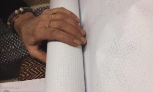 Hands touching handmade items